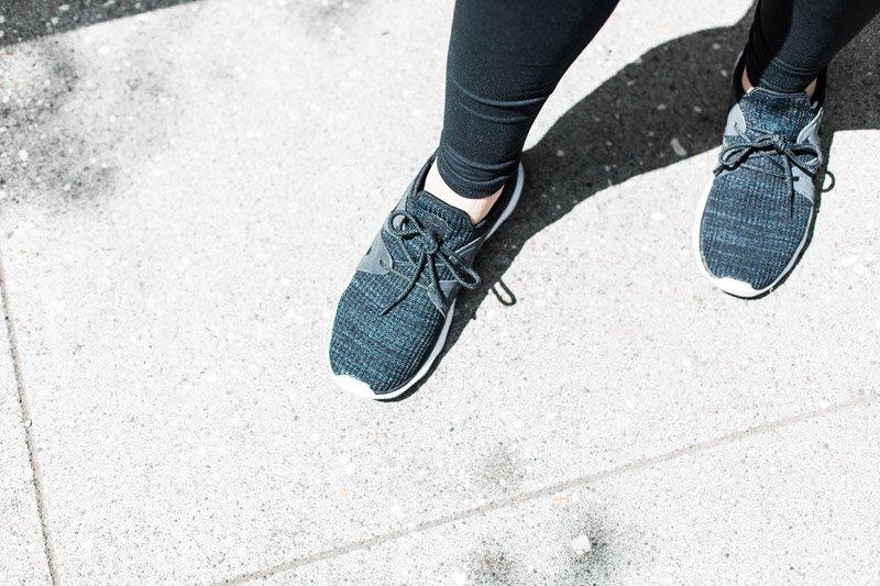woman's walking shoe clad feet