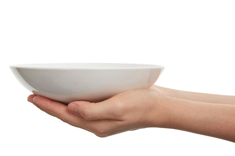 Hands holding empty bowl