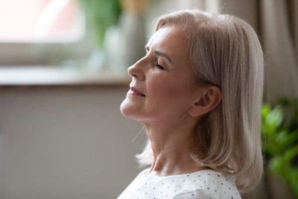middle-aged mindful woman contemplating obstacles to getting fit